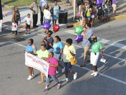A group parades down Main Street during the 11th annual African-American Heritage Festival.