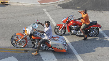 Above, several festival-goers used the chance to get their bikes in this year's parade.