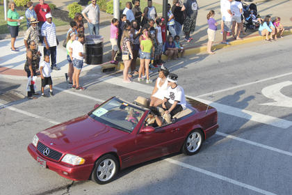 The 2014 Washington County Prom Queen and King, Shae Lewis and Tyus Lewis, roll down Main Street.