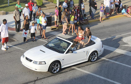 Gabby Sims, third runner-up in the 2015 Washington County Distinguished Young Woman competition and winner of the fitness competition, and DYW winner Erika Weir got their turn to wave to the crowd.