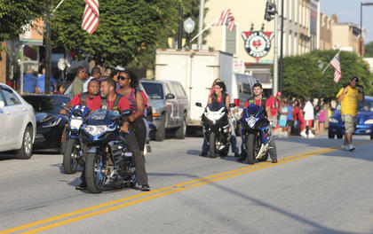A group creeps down Main Street on their motorcycles during Friday's parade.