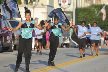 Above, members of the River City Drum Corp out of Louisville take part in the African-American Heritage Festival parade over the weekend. Dr. Gabrielle J. Grundy, MD, was the grand marshal of the parade, and the Jimmy Church Band performed for the nightcap.