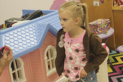 Kimberly Keeling plays with a doll house at NWES.
