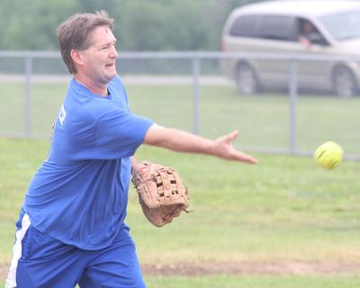 Billy Coulter warms up before a softball tournament.