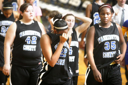 Freshman Jennifer Keene (22) walked off the court with her teammates after a 53-46 season-ending loss to LaRue County on March 1. The Commanderettes finished the season with a 15-14 record.