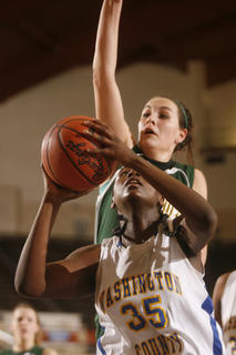 Sophomore Kenya Turner attacked the basket against Owensboro Catholic sophomore Rebecca Greenwell in the Commanderettes 71-52 loss. 