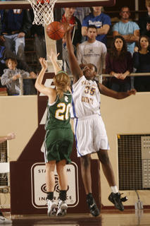 Sophomore Kenya Turner went up for Owensboro Catholic junior Stephanie Dooper&#039;s shot on Wednesday. 