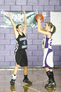 Senior Linda Libby applied defensive pressure to Bardstown junior Abbie Parrish in Washington County's 48-45 win.