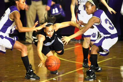 Junior Shay Yocum went after a loose ball against Bardstown on Saturday at Caverna High School.