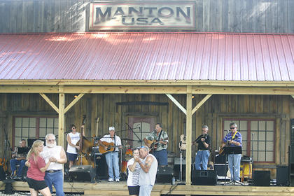 Crowd members danced to the live music on Sunday at the Manton Music Jam. Sunday's crowd was the largest crowd ever for the event.