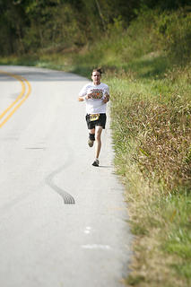 A runner neared the crossroads of Manton before finishing the fourth leg of the race.