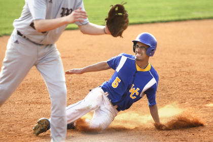 Washington County senior Markus Reardon slid into third base with no threat of being tagged out against Marion County in the season opener.