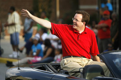 State Representative Mike Harmon waved to the crowd during the parade.