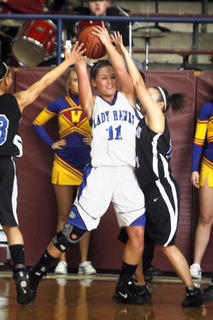 Senior Moriah Hourigan applied heavy defensive pressure to LaRue County senior Valerie Whitlock during the first half against LaRue. 