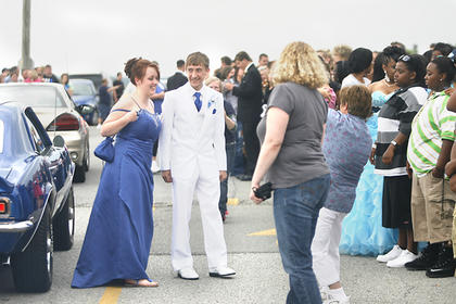 Sidney Smith, left, and Chris Carrico, right, rode to prom in a classic car. 