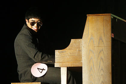 Rogelio Garza, at piano, did a performance to a Ray Charles song for his talent routine.