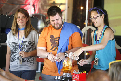 Seth Heller, center, dumped the contents of a Happy Meal into a blender on Thursday.