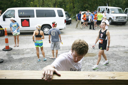 A runner limbered up at Manton General Store before taking off on his next leg of the race.