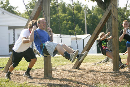 Campers took advantage of a little bit of free time on the swing set at Camp Calvary.