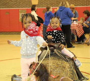 Kaydence Spalding, left, and Mikayla Hughes have a ball roping a toy pony.