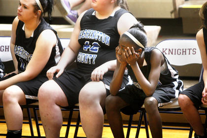 Eighth grader India Yocum watches in the final moments as Washington County starts to slip away against LaRue County. 