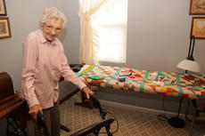 """<div class=""""source"""">Geoff Hamill</div><div class=""""image-desc"""">Clara Mae Blandford at her quilting rack, where she is working on a """"Jacob's Ladder"""" patterned quilt. </div><div class=""""buy-pic""""><a href=""""/photo_select/14552"""">Buy this photo</a></div>"""