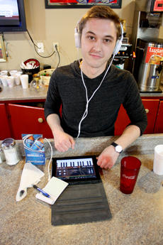 "<div class=""source"">Brent Schanding</div><div class=""image-desc"">Johnathon Barlow, 22, who manages family-owned Cecconi's restaurant downtown is working on his swagger as a musician. When he's not at the diner, Barlow plays several instruments and records and mixes tracks on his iPad.  </div><div class=""buy-pic""><a href=""/photo_select/13878"">Buy this photo</a></div>"