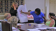 """<div class=""""source"""">Geoff Hamill</div><div class=""""image-desc"""">City Administrator Laurie Smith and Councilmember Debbie Wakefield display a map of the Fairground Avenue area to Springfield Council on July 9. Council is considering deeding part of the right-of-way to the Library Board and two private landowners. </div><div class=""""buy-pic""""><a href=""""/photo_select/14617"""">Buy this photo</a></div>"""