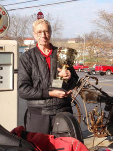 "<div class=""source""></div><div class=""image-desc"">Sherrell Cornish posed with his first-place trophy after topping his buddy, Bill Newton, in mileage for the first time in three tries. </div><div class=""buy-pic""><a href=""/photo_select/13882"">Buy this photo</a></div>"