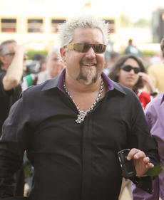 "<div class=""source"">Jeff Moreland</div><div class=""image-desc"">Celebrity chef Guy Fieri was just one of the many famous people to attend Saturday's Kentucky Derby.</div><div class=""buy-pic""><a href=""/photo_select/8604"">Buy this photo</a></div>"