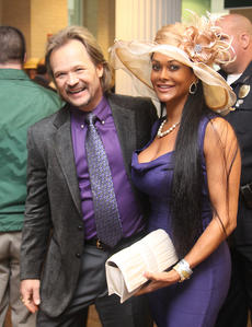 "<div class=""source"">Jeff Moreland</div><div class=""image-desc"">Country musician Travis Tritt, and his wife, Theresa Nelson, left the red carpet and headed to Millionaire's Row at The Kentucky Derby Saturday.</div><div class=""buy-pic""><a href=""/photo_select/8606"">Buy this photo</a></div>"