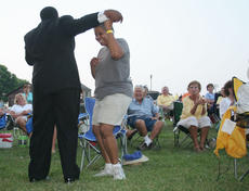 """<div class=""""source"""">Jeff Moreland</div><div class=""""image-desc"""">The crowd was on its feet, dancing and singing along as members of Bill Pinkney's Original Drifters worked the audience during their Saturday night concert at Idle Hour Park.</div><div class=""""buy-pic""""><a href=""""/photo_select/1387"""">Buy this photo</a></div>"""