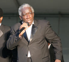"""<div class=""""source"""">Jeff Moreland</div><div class=""""image-desc"""">Richard Dunbar, a member of Bill Pinkney's Original Drifters, cranked out a classic tune as part of the Springfield-Washington County Chamber of Commerce's Summer Concert Series Saturday night at Idle Hour Park.</div><div class=""""buy-pic""""><a href=""""/photo_select/1389"""">Buy this photo</a></div>"""