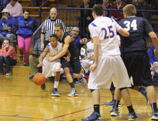 """<div class=""""source"""">Photo by Brandon Mattingly</div><div class=""""image-desc"""">Senior Markuise Stateman came up with this steal and hit junior Tylyn Byas for a layup to put Washington County up by five heading into halftime against Thomas Nelson on Friday. The Commanders went on to a 67-65 victory.</div><div class=""""buy-pic""""><a href=""""/photo_select/13795"""">Buy this photo</a></div>"""
