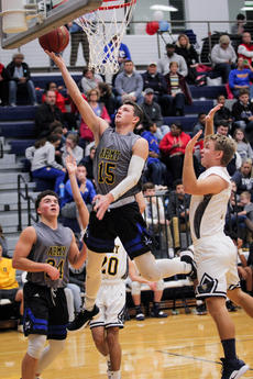 """<div class=""""source"""">Zack Peñalva</div><div class=""""image-desc"""">Drew Yates lays the ball into the basket during the Commanders win over Thomas Nelson. Yates finished the game with 10 points and 10 rebounds.</div><div class=""""buy-pic""""><a href=""""/photo_select/25589"""">Buy this photo</a></div>"""