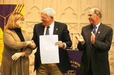 """<div class=""""source"""">Jesse Osbourne</div><div class=""""image-desc"""">From left to right, Mary Berry-Smith with The Berry Center, St. Catharine College President William D. Huston and SCC board of trustees chairman Joe Kelly celebrated after signing a proclamation that would officially form a partnership between St. Catharine College and The Berry Center.  </div><div class=""""buy-pic""""><a href=""""/photo_select/11009"""">Buy this photo</a></div>"""
