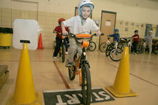 """<div class=""""source"""">Jimmie Earls</div><div class=""""image-desc"""">Washington County Elementary student Toby Dickerson sets out on the bicycle road safety course offered last Tuesday by Kosair Children's Hospital in collaboration with the Washington County Family Resource and Youth Services Center.</div><div class=""""buy-pic""""><a href=""""/photo_select/4157"""">Buy this photo</a></div>"""