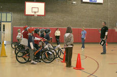 """<div class=""""source"""">Jimmie Earls</div><div class=""""image-desc"""">Doug Beckhart, right, bicycle safety educator with Kosair Children's Hospital, instructs Washington County Elementary students on the importance of wearing a helmet when riding and overall bike safety.</div><div class=""""buy-pic""""><a href=""""/photo_select/4156"""">Buy this photo</a></div>"""