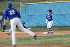 """<div class=""""source"""">Trent Taylor</div><div class=""""image-desc"""">Josh Cain makes a pick off move to first where Grant Hilton attempts to make the tag. Photo by Trent Taylor</div><div class=""""buy-pic""""><a href=""""/photo_select/26349"""">Buy this photo</a></div>"""