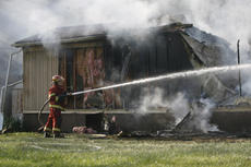 """<div class=""""source"""">Jesse Osbourne</div><div class=""""image-desc"""">Firefighters battled a blaze at 2713 Tatum Springs Road in Willisburg on Friday afternoon. </div><div class=""""buy-pic""""><a href=""""/photo_select/10359"""">Buy this photo</a></div>"""