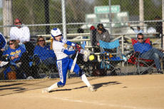 "<div class=""source"">Zack Peñalva</div><div class=""image-desc"">Fran Taylor gets a hit during the Commanderettes win over St. Henry at the All 'A' State Tournament.</div><div class=""buy-pic""><a href=""/photo_select/24356"">Buy this photo</a></div>"