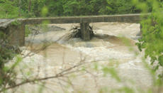 "<div class=""source"">Jeff Moreland</div><div class=""image-desc"">Water rushed under this bridge off of KY 150 as rain continued to fall Sunday afternoon.</div><div class=""buy-pic""><a href=""http://web2.lcni5.com/cgi-bin/c2newbuyphoto.cgi?pub=023&orig=flood4.jpg"" target=""_new"">Buy this photo</a></div>"