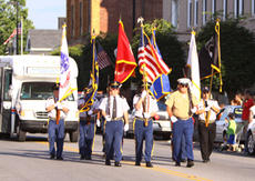 """<div class=""""source"""">Jeff Moreland</div><div class=""""image-desc"""">Members of the Marion County Veterans Honor Guard led the way as the Springfield Independence Day Parade made its way down Main Street Friday evening. This year's parade was themed to honor our nation's veterans.</div><div class=""""buy-pic""""><a href=""""/photo_select/2066"""">Buy this photo</a></div>"""