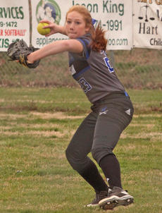 """<div class=""""source""""></div><div class=""""image-desc"""">Sophomore Elizabeth Riley throws towards first base from the outfield during the Commanderettes away game against Hart County.</div><div class=""""buy-pic""""><a href=""""/photo_select/21042"""">Buy this photo</a></div>"""