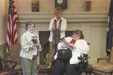 """<div class=""""source"""">Photo by Brandon Mattingly</div><div class=""""image-desc"""">BPW President Ginny White-Schatzke, center, presented Shelia Hourigan, left, and Cassie Robinson with their awards, as they were named the 2013 Women of Achievement.</div><div class=""""buy-pic""""><a href=""""/photo_select/15248"""">Buy this photo</a></div>"""