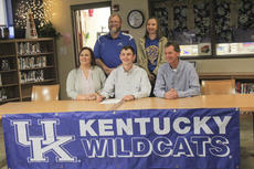 """<div class=""""source"""">Zack Peñalva</div><div class=""""image-desc"""">Mason Hamilton signed with the UK rifle team Thursday. He was joined by his family and vice principal Tim Messer.</div><div class=""""buy-pic""""><a href=""""/photo_select/25456"""">Buy this photo</a></div>"""