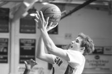 """<div class=""""source"""">Jesse Osbourne</div><div class=""""image-desc"""">Washington County High School senior Jared Kelty pulled up for a jumper against Marion County on Saturday at Washington County.  </div><div class=""""buy-pic""""><a href=""""/photo_select/8053"""">Buy this photo</a></div>"""