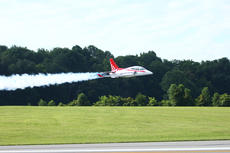"""<div class=""""source"""">Zack Peñalva</div><div class=""""image-desc"""">A model plane leaves behind a vapor trail as it flies over the runway at the airport.</div><div class=""""buy-pic""""><a href=""""/photo_select/24700"""">Buy this photo</a></div>"""