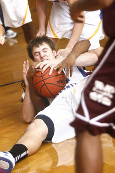 "<div class=""source"">Jesse Osbourne</div><div class=""image-desc"">Junior Kyle Curtsinger fought for a loose ball against Marion County on Saturday. 