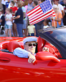 """<div class=""""source"""">Jeff Moreland</div><div class=""""image-desc"""">Springfield Mayor John W. Cecconi was one of the many veterans to ride in a Corvette during Friday evening's Independence Day Parade in downtown Springfield.</div><div class=""""buy-pic""""><a href=""""/photo_select/2064"""">Buy this photo</a></div>"""